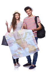 Couple of tourists holding map
