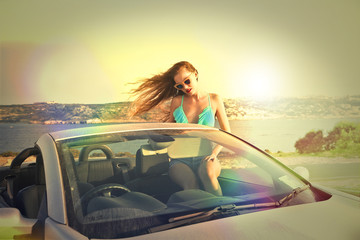 beautiful woman in a cabrio