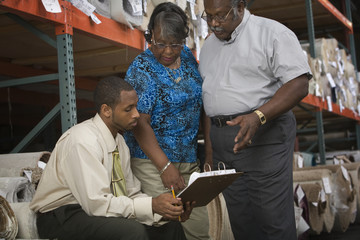African American couple in carpet warehouse