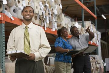 African American sales representative in carpet warehouse