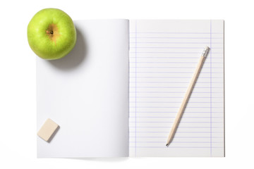 Notebook and Green Apple with Clipping Path