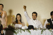 Hispanic newlyweds toasting with champagne
