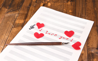 Music notes in music note book. Concept of love melody