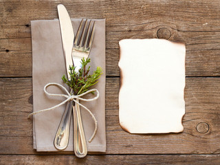 Rustic Table setting and old burned paper