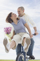 African American couple riding bicycle