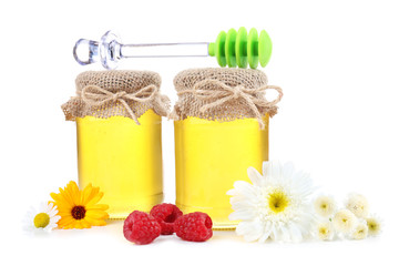 Jar full of delicious fresh honey and wild flowers, isolated