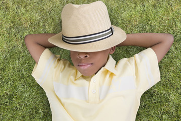 African American boy laying in grass