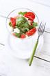 Salad with watermelon, feta cheese, arugula, tomatoes, sesame