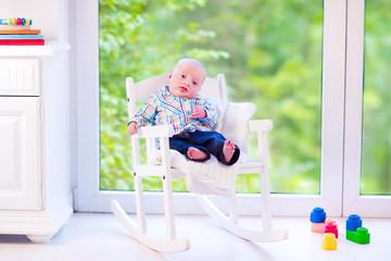 Baby boy n a rocking chair