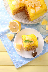 Tasty lemon dessert on wooden table