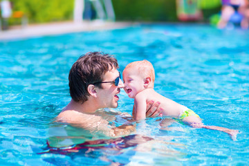 Father and baby in a swimming pool
