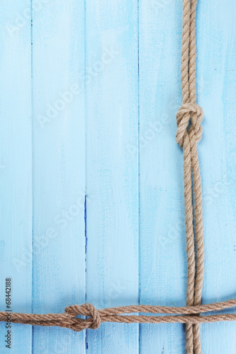 Marine knots on wooden background
