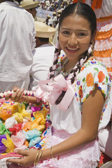 Hispanic woman with offerings at festival
