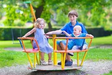 Three kids on a swing