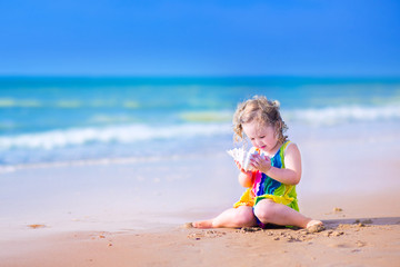 Little girl with a seashell