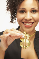 Mixed Race woman wearing dollar sign necklace