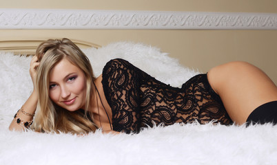 The beautiful girl the blonde on bed