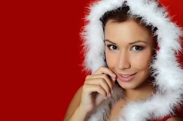 The Christmas girl on a red background