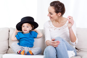 Mother and child wearing hat