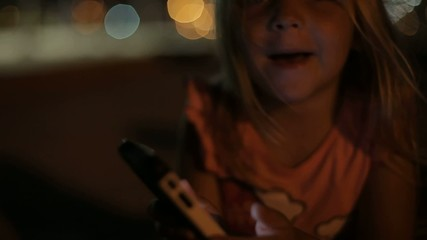 my daughter playing with the phone. israel. Ashdod.