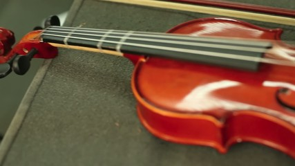 Travel music orange violin detail