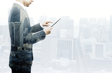 businessman standing with tablet