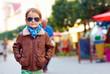 stylish kid walking city street, autumn fashion