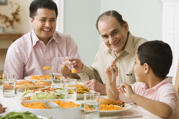 Hispanic family at dinner table