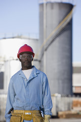 African American male construction worker wearing hardhat
