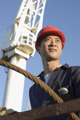 Asian male construction worker wearing hardhat