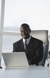 African American businessman typing on laptop