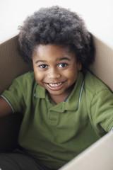 African American boy sitting in box