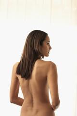 Rear view of nude Hispanic woman