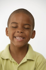 African American boy with eyes closed