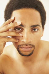 African American man with hand on face