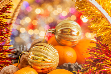 Gold Christmas ball in the basket with fruits and nuts