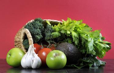Shopping basket full of fruit and vegetables.