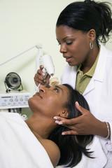 African woman receiving spa facial treatment