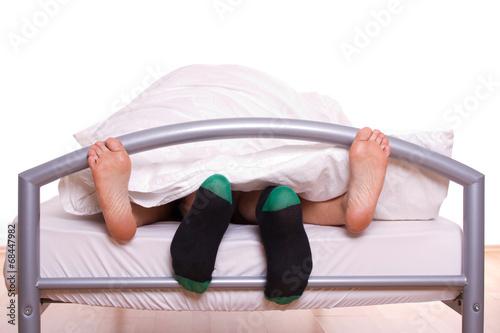canvas print picture Füße bei Sex - Mann mit Socken