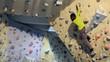 Child exercising in bouldering gym