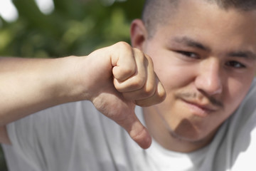 Pacific Islander man giving thumbs down