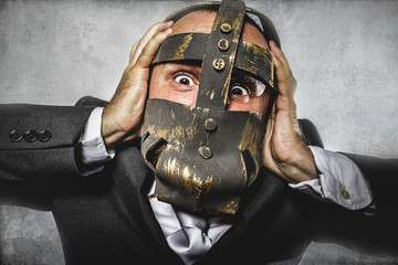 pulling, dangerous business man with iron mask and expressions