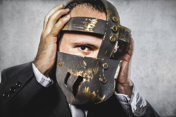 frustrated, dangerous business man with iron mask and expression