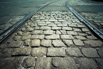 Vintage cobblestone street and railroad tracks