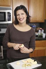 Pregnant Hispanic woman preparing food