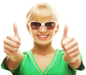casual girl showing thumbs up and smiling