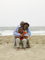 African family sitting on beach