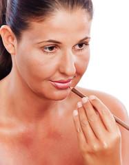 Beauty treatment woman applying Make up