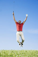 African man cheering on golf course