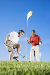 Multi-ethnic men playing golf